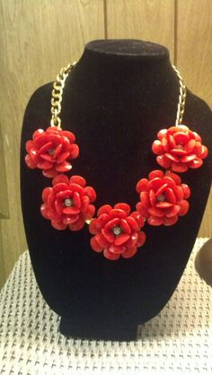 Brand new plastic flower necklace (maybe pre-owned?) becomes vintage on mendacious Etsy.  Buy it new from the ILY site:  http://www.ilycouture.com/product_p/blnkl.htm
