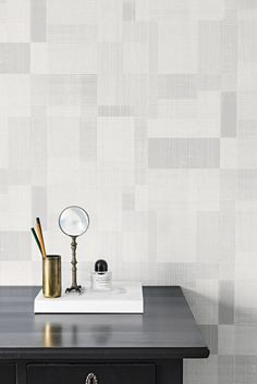 This clever geometric wallpaper design is actually a smooth design with a textured effect.