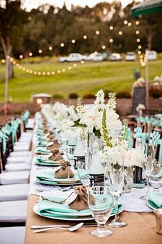 Mint colors and burlap featured at this outdoor wedding reception.
