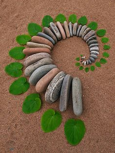 Artist Uses Rocks And Leaves To Form Beautiful, Circular Land Art - DesignTAXI.com