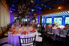 Blue lighting complementing this wedding reception at the Sundy House