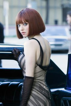 Amanda Seyfried - In Time; only recently seen this film and was struck by Amanda's hair style and the dress she is wearing.  A great look.