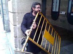 Spanish Musician Plays a Street Barrier Like a Flute