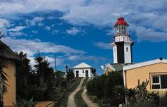 The Great Fish Point lighthouse near Port Alfred in the Eastern Cape is one of South Africa's smallest lighthouses – but it casts a beacon light that can shine for up to 32 nautical miles out to sea. Beacon Lighting, Out To Sea, Being In The World, Light House, Shipwreck, Hotels And Resorts, Towers, Luxury Travel, South Africa