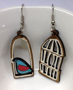 A personal favorite from my Etsy shop https://www.etsy.com/listing/265986581/colorful-bird-and-white-cage-earrings