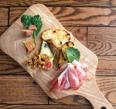 Prosciutto, fig, and blue cheese bruschetta with walnut jam. Recipe by Eli Wahl, Executive Chef, Casbah.
