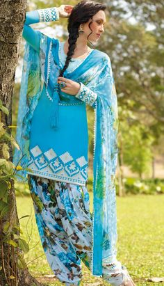 Our exclusive collection of suits are in wide demand in global marketplace. Keep ahead in the fashion race by wearing this shaded turquoise color cotton #salwarkameez is showing some amazing embroidery done with resham, print and patch patti work in form of floral motif. Beautiful embroidered border is highlighting the royalty of the kameez. Contrasting printed salwar and dupatta is available