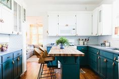 blue cabinets, airy kitchen