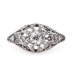 Elegant Three Stone Platinum Engagement Ring   Silver Quill from Trumpet &…