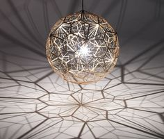 Etch Web is a vast 65cm wide shade with an unusual open structure, designed to cast atmospheric angular shadows when lit.