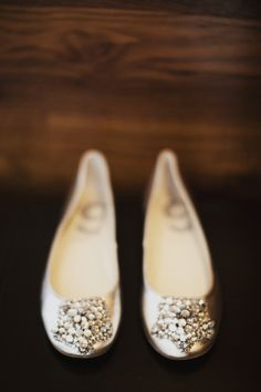 I wonder if these are shoe clips or part of the shoes? I hate that they never list where the shoes came from on wedding blogs!    #silver #wedding #shoes