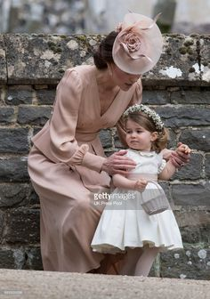 Catherine, Duchess of Cambridge and Princess Charlotte of Cambridge attend the wedding of Pippa Middleton and James Matthews at St Mark's Church on May 20, 2017 in Englefield Green, England.
