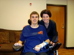 David Hudgik, a teen living with a spinal cord injury, receives Reiki treatment from Dana Lisa Young of Dragonfly Reiki
