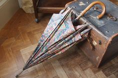 COLLIER CAMPBELL umbrella and Vintage travel trunk coffee table -£65.00  +p&p each at carmelward.co.uk/linen-and-lace/