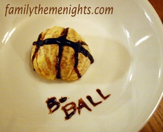 A (mostly) healthy snack for the basketball fan!  Half a peeled orange with chocolate syrup lines.  This idea and more March Madness fun for kids at http://familythemenights.com