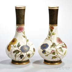 Two Wedgwood Ivory Vellum Vases, England, c. 1885, each bottle-shape,with polychrome enamel and gilt floral designs, printed and impressed marks, ht. 12 5/8 in.