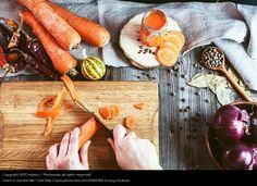 female hands chopped fresh carrot slices