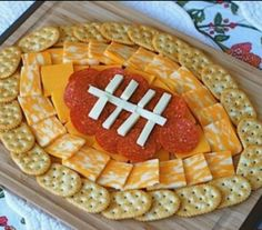 Easy gametime snack: Set up your crackers, cheese and pepperoni in the shape of a football! |  #MarchMadness - Pin it to Win it! See our Plated Meals board for our contest details. Enter to win 6 free plates at Plated.com! Ends March 31, 11:59pm.