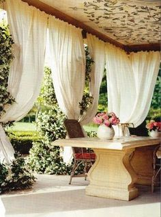 Outdoor  drapes.....this is outdoor living at it's finest!