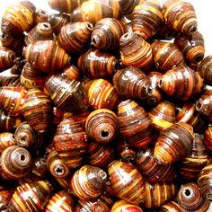Beautiful, round, fat & fun recycled paper beads. A mix of wonderful vibrant and glossy colours for all kinds of jewelry making and crafting. GET CHUNKY BRIGHT & FUNKY...without the weight!  Buy now www.mzuribeads.com/