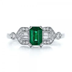 This is pretty and uniqure. Custom Emerald and Diamond Engagement Ring | Joseph Jewelry Seattle Bellevue