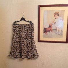 Vintage daisy print skirt 5 buttons up the side, flowy, and perfect for any occasion! So stinkin cute  Express Skirts