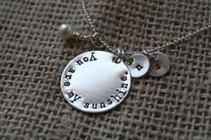 Hand Stamped Sterling Silver Necklace - You are my sunshine. $34.00, via Etsy.