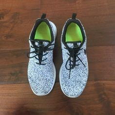 Speckled Nike roshe runs Black, white, and gray speckled nikes with black laces and black swoosh. They are warn Nike Shoes Sneakers