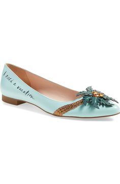A trio of eye-catching beads center a tropical palm appliqué on this chic pointy-toe flat by Kate Spade that channels all of the fave warm-weather vacation daydreams.