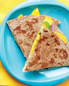 Goat Cheese and Mango Quesadillas Game Day Recipes | Martha Stewart Living - For a tropical twist on the classic quesadilla, add slices of ripe mango. It works surprisingly well with the goat cheese, red onion, jalapeno, and cilantro in this sweet-and-savory recipe.