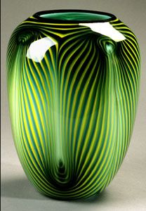 Feather Pattern Vase by Dehanna Jones, Glass Artist This vase matches the Feather Bowls in color. The colors are both opaque and transparent with a high contrast and all have the Feather pattern on the outside.