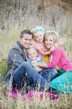 Family of 4 pose - leads to an amazing blog & photographer's website. Great color choices, poses, photo settings- it helps that this family is beautiful!