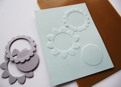 use chipboard die cuts for embossing