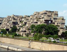 Habitat 67 (Montreal, Canada)  The cube is the base, the mean and the finality of Habitat 67. In its material  sense, the cube is a symbol of stability. As for its mystic meaning, the cube is symbol of wisdom, truth, moral perfection, at the origin itself of our civilization.    354 cubes of a magnificent grey-beige build up one on the other to form 146 residences nestled between sky and earth, between city and river, between greenery and light.