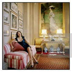 At Blenheim Palace: Lily Spencer-Churchill, the current Duchess of Marlborough, photographed for Vanity Fair Magazine (25-27 Oct 2010) with a 1903 portrait of Consuelo Vanderbilt in the background, Woodstock, England.
