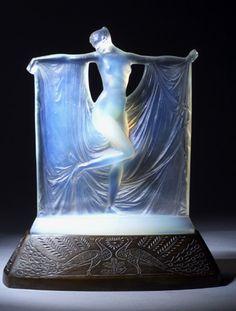Rene Lalique :: `Suzanne` statuette, circa 1925, in opalescent glass, with bronze peacock pattern illuminating base.