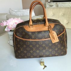 Deauville Louis Vuitton Authentic. Free ship! Flawless inside. Perfect patina color. $500 on M. Small watermark on leather as shown in photo. Postmark will authenticate before delivering to you. Perfect travel bag. Too big to carry every day, in my opinion. This is not the small hand bag size (that one is called Trouville). No dust bag, but LV stores usually give you one if you ask. 1 key only and 1 lock. To close the lock, you have to use key to lock it. Louis Vuitton Bags