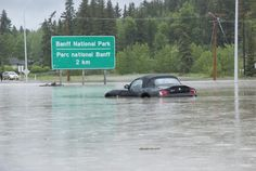 anmore, Alberta Canada	Date shot: June 20, 2013     BMW flooded on the way to Banff on #1 Highway near Canmore, AB