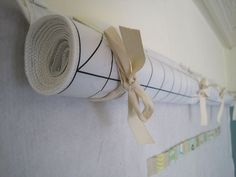 How to make a doubled design wall from Sew Katie Did...Sew doubled up ribbon to the top of one design wall. Place your project…work on it.  When you get bored with it, roll up that design wall and tie it with some pretty bows…work on wall underneath... clever!