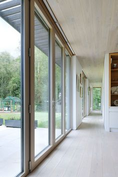 Series of glass doors connects the indoors with the deck outside