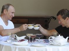 PHOTO: Russian President Vladimir Putin and Prime Minister Dmitry Medvedev toast with tea cups during breakfast at the Bocharov Ruchei state residence in Sochi, Russia, Aug. 30, 2015.
