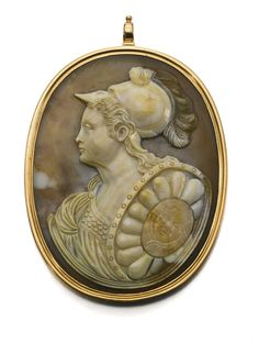 AN AGATE CAMEO OF EMPRESS CATHERINE II AS MINERVA, CIRCA 1780 facing dexter, wearing a plumed helmet and bearing a shield with applied central mask medallion, gold pendant mount - Dim: 5.6cm,