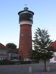 Tønder, Denmark. What is most fascinating about the Tønder Water Tower is its dual purpose. Not only does it hold water, as its name would suggest, it also houses a Danish chair museum. A collection of Arne Jacobsen's chairs is featured at this lighthouse-like tower.