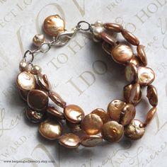 Rose Copper Coin Pearl 3 Strand Bridal Bracelet -- Cultured Pearls and Sterling Silver - for the Champagne Bride. $112.00, via Etsy.