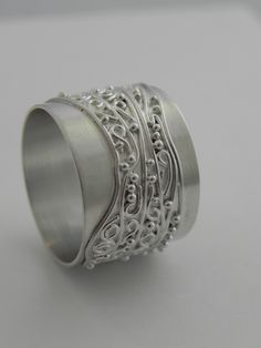 """""""Spiral"""" ring. Wide silver band with spirals, wire and silver balls. Handcrafted by Quench & Pickle."""