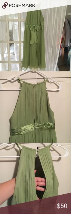 SALE TODAY Spring Green Maggy London silk dress Beautiful and in perfect condition. Hits a little below the knee. 100%silk crepe with a halter yolk neck and one silk button in the back. Wore once in a wedding. Maggy London Dresses Midi