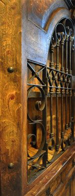 Rustic Furniture with Wrought Iron, I have always loved the huge wooden front doors with the rustic iron design...
