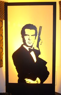 A Pierce Brosnan back lit silhouette panel from themed evenings for your James Bond theme Party
