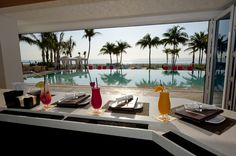 Tropical drinks and beautiful ocean views at Beach Bar & Grill