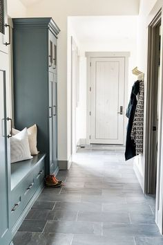 This farmhouse features natural slate floor tile and light grey door and trim, painted in Benjamin Moore Chelsea Gray at 25%. Studio McGee. Home Bunch blog